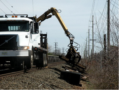 Photos of the railroad tie and scrap metal track cleanup