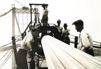 Compacting suspended span bridge cables, July 1935