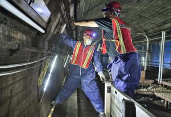 Maintainers Installing Cable Box Inside Greenpoint Tube