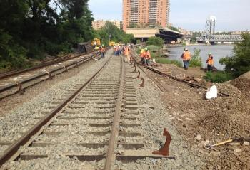 Third rail brackets being installed