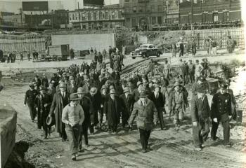 Mayor Fiorello La Guardia leads the inspection party as it emerges from the top of the construction shaft in Queens.